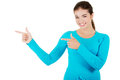 Happy woman pointing to the left Royalty Free Stock Photo