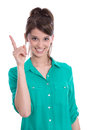 Happy woman pointing up with her finger in green isolated over white Royalty Free Stock Image