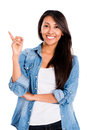 Happy woman pointing up with her finger isolated over white Royalty Free Stock Images