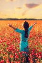 Happy woman in poppies meadow. Royalty Free Stock Photo