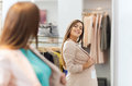 Happy woman posing at mirror in clothing store Royalty Free Stock Photo