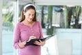 Happy woman preparing agenda in diary Royalty Free Stock Photo