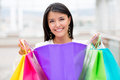 Happy woman with purchases Royalty Free Stock Photo