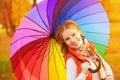 Happy woman with rainbow multicolored umbrella under rain in par Royalty Free Stock Photo