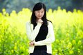 Happy woman in rapeseed field young asia Royalty Free Stock Photo