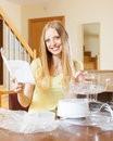 Happy woman reading user manual for steamer blonde new electric at home Stock Photos