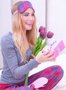 Happy woman receive gifts portrait of cute sitting on the bed and enjoying tulip bouquet romantic relationship valentine day Royalty Free Stock Photos