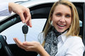 Happy woman receiving car key Stock Photo