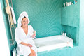 Happy woman relaxing bathroom spa wellbeing hotel Stock Image