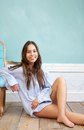 Happy woman relaxing at home and leaning on chair portrait of a Royalty Free Stock Photography