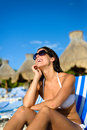 Happy woman relaxing on vacation at tropical resort beach joyful caribbean looking up to the blue sky summertime tourism and Royalty Free Stock Photo
