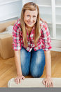 Happy woman rolling a carpet out Royalty Free Stock Photos