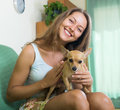 Happy woman with russian toy in arms young Stock Images
