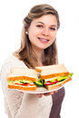 Happy woman with sandwiches Stock Photography