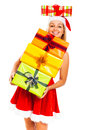 Happy woman in Santa costume with Christmas gifts Stock Photo