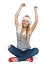 Happy woman in Santa hat with arms raised Stock Photography