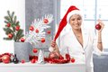 Happy woman in santa hat at christmas smiling claus with decoration red bulb handheld Royalty Free Stock Photography