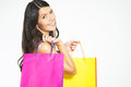 Happy woman shopper with colorful bags full of her recent purchases turning to smile at the camera a look of satisfaction and Stock Image