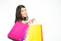 Happy woman shopper with colorful bags full of her recent purchases turning to smile at the camera a look of satisfaction and Stock Photo