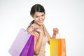 Happy woman shopper with colorful bags full of her recent purchases turning to smile at the camera a look of satisfaction and Royalty Free Stock Photography