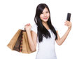 Happy woman with shopping bag and cellphone asian isolated on white Royalty Free Stock Image