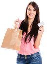 Happy woman shopping credit card isolated over white Stock Photography