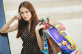 Happy woman shopping and holding bags at the mall Royalty Free Stock Photo