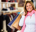 Happy woman shopping holding bags smiling Stock Photos
