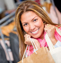 Happy woman shopping mall holding bags Stock Photos