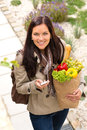 Happy woman shopping phone groceries texting vegetables Stock Photo