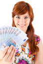 Happy woman showing euros currency notes on white background Royalty Free Stock Images
