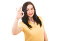 Happy woman showing okay in blank yellow tshirt sign hand gesture isolated on white background Stock Photo