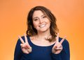 Happy woman showing victory sign Royalty Free Stock Photo