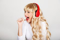 Happy woman singing and listening to the music. Royalty Free Stock Photo