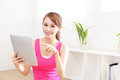 Happy woman smiles using tablet pc and looking to you at home asian beauty model Royalty Free Stock Photos