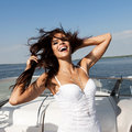 Happy woman smiling on boat looking at the sea sailing by caucasian female model outdoors lifestyle Stock Image