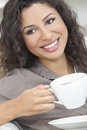 Happy Woman Smiling Drinking Tea or Coffee Stock Images