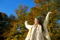 image photo : Happy woman smiling and enjoying an autumn day outdoors