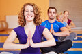 Happy woman smiling in yoga class Stock Image
