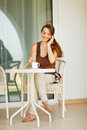 Happy woman speaking mobile phone at terrace Royalty Free Stock Images