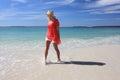 Happy woman splashing feet at the beach Royalty Free Stock Photo