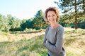 Happy woman standing in countryside with arms crossed Royalty Free Stock Photo