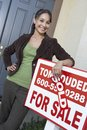 Happy Woman Standing By Sign Board Royalty Free Stock Photo