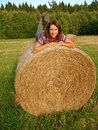 Happy Woman on Straw Bale Royalty Free Stock Photos