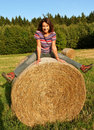 Happy Woman on Straw Bale Stock Image