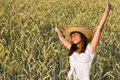 Happy woman with straw hat in corn field Royalty Free Stock Photo