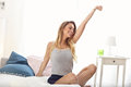 Happy woman stretching in the morning Royalty Free Stock Photo