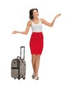 Happy woman with suitcase greeting picture of Stock Photography