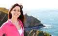 Happy woman on summer coast landscape travel smiling nature background beautiful brunette girl enjoying the view in asturias Royalty Free Stock Photo