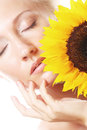 Happy woman with sunflower Royalty Free Stock Photo